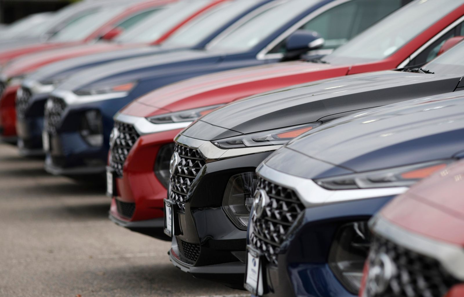 FILE - In this May 19, 2019, file photo, a line of unsold 2019 Tucson sports-utility vehicles sits at a Hyundai dealership in Littleton, Colo.{ } (AP Photo/David Zalubowski, File)