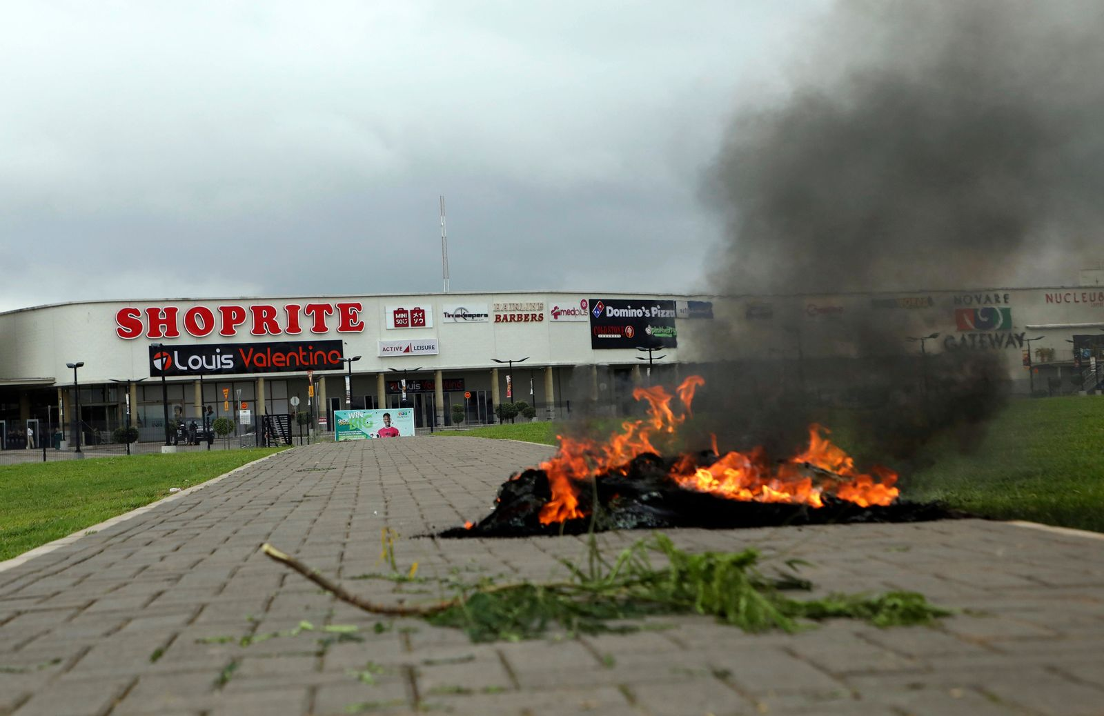 A bonfire is set outside Shoprite during a protest in Abuja, Nigeria Wednesday. Sept. 4, 2019.{ } (AP Photo)