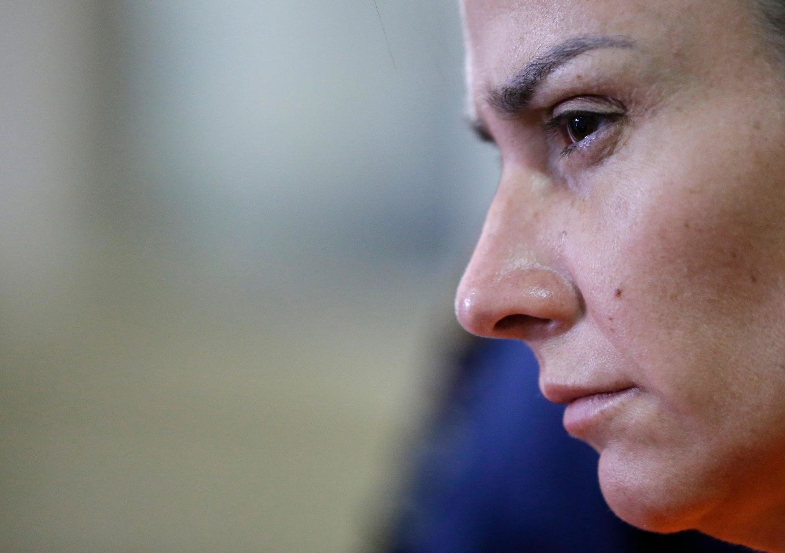 Arrested American Jennifer Erin Talbot from Ohio watches during a press conference by the National Bureau of Investigation (NBI) in Manila, Philippines on Thursday, Sept. 5, 2019. (AP Photo/Aaron Favila)