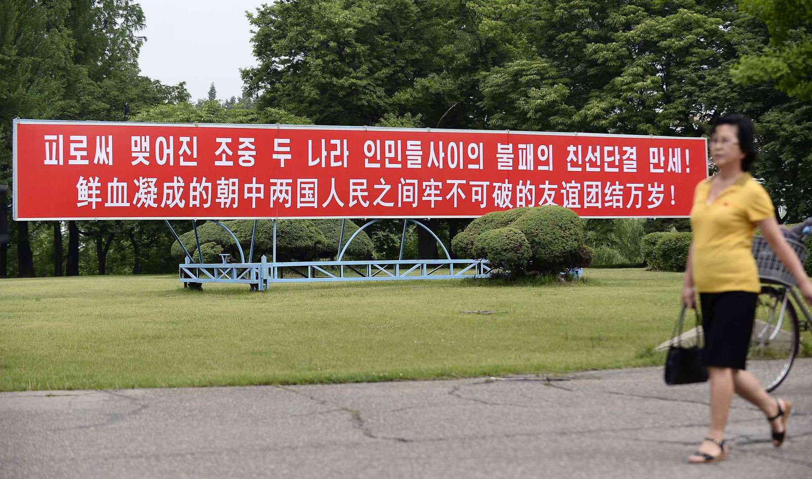 "The signboard, which reads ""Long Live with Unbreakable Friendship and Unity Formed by Blood"" in Chinese and Korean language respectively, is displayed in Pyongyang, North Korea, Thursday, June 20, 2019. (Kyodo News via AP)"