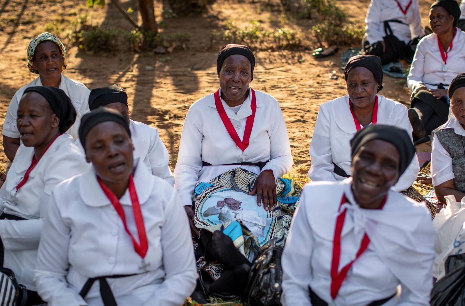 Women from different churches wait to see Pope Francis, ahead of his expected arrival near to the Apostolic Nunciature in the capital Maputo, Mozambique Wednesday, Sept. 4, 2019. Pope Francis is opening a three-nation pilgrimage to southern Africa with a strategic visit to Mozambique, just weeks after the country's ruling party and armed opposition signed a new peace deal and weeks before national elections. (AP Photo/Ben Curtis)