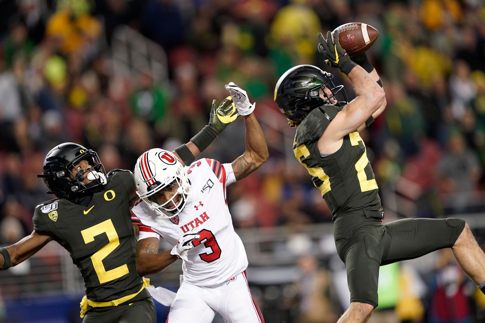 Oregon safety Brady Breeze, right, intercepts a pass intended for Utah wide receiver Demari Simpkins (3) as Oregon cornerback Mykael Wright (2) defends during the first half of the Pac-12 Conference championship NCAA college football game in Santa Clara, Calif., Friday, Dec. 6, 2018. (AP Photo/Tony Avelar)
