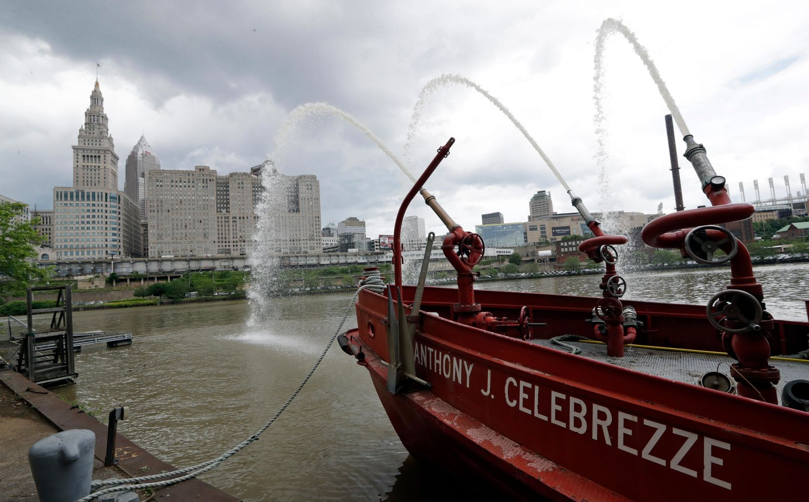 The Anthony J. Celebrezze rests near Fire Station 21 on the Cuyahoga River, Thursday, June 13, 2019, in Cleveland. Fire Station 21 battles the fires on the Cuyahoga River. The Celebrezze extinguished hot spots on a railroad bridge torched by burning fluids and debris on the Cuyahoga in 1969. (AP Photo/Tony Dejak)