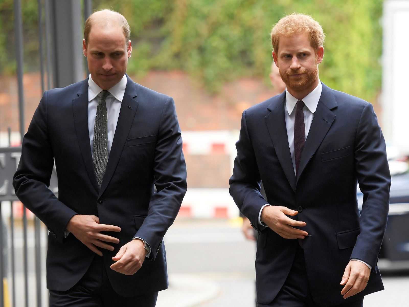 FILE  - In this Tuesday, Sept. 5, 2017 file photo, Britain's Prince William, the Duke of Cambridge, left, and Prince Harry arrive to visit the Support4Grenfell Community Hub in London. Britain's Queen Elizabeth II is set to hold face-to-face talks Monday, Jan. 13, 2020 with Prince Harry for the first time since he and his wife, Meghan, unveiled their controversial plan to walk away from royal roles — at a dramatic family summit meant to chart a future course for the couple. The meeting at the monarch's private Sandringham estate in eastern England will also include Harry's father Prince Charles and his brother Prince William. (Toby Melville/ Pool via AP, File)