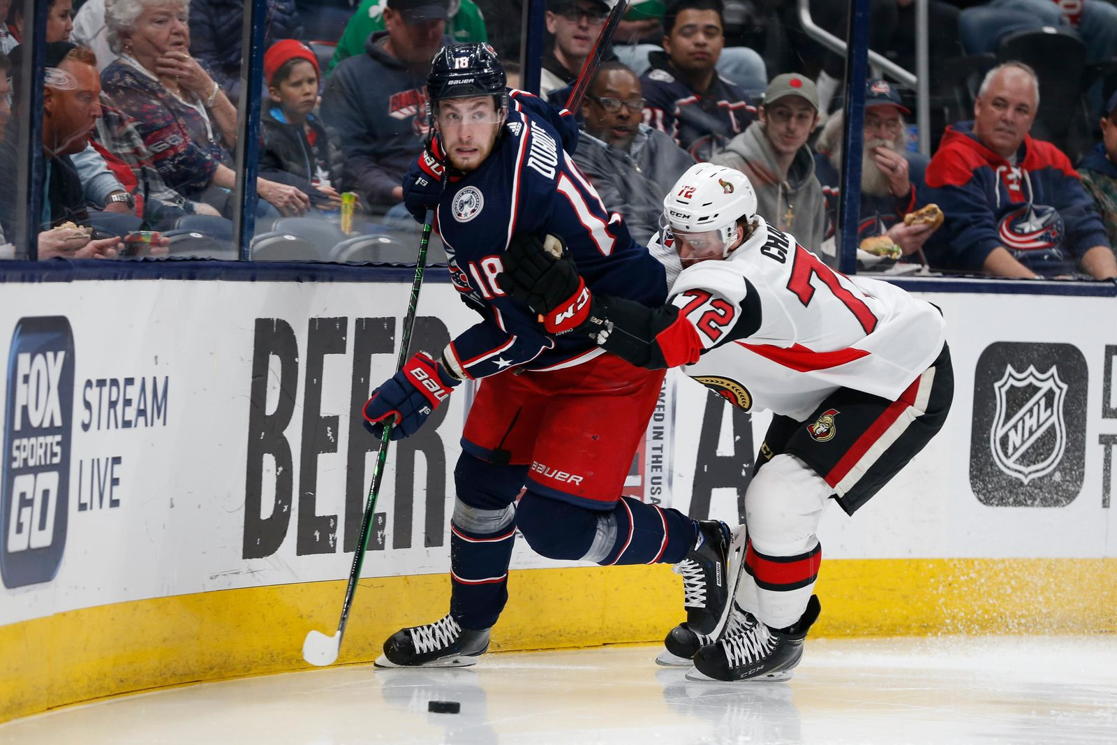 Columbus Blue Jackets' Pierre-Luc Dubois, left, looks for an open pass as Ottawa Senators' Thomas Chabot defends during the second period of an NHL hockey game Monday, Feb. 24, 2020, in Columbus, Ohio. (AP Photo/Jay LaPrete)