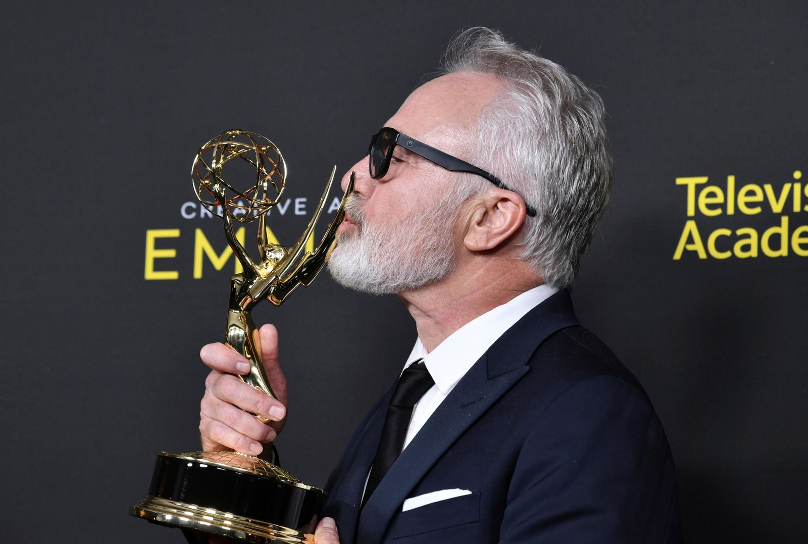 "Bradley Whitford poses in the press room with the award for outstanding guest actor in a drama series for ""The Handmaid's Tale"" on night two of the Creative Arts Emmy Awards on Sunday, Sept. 15, 2019, at the Microsoft Theater in Los Angeles. (Photo by Richard Shotwell/Invision/AP)"