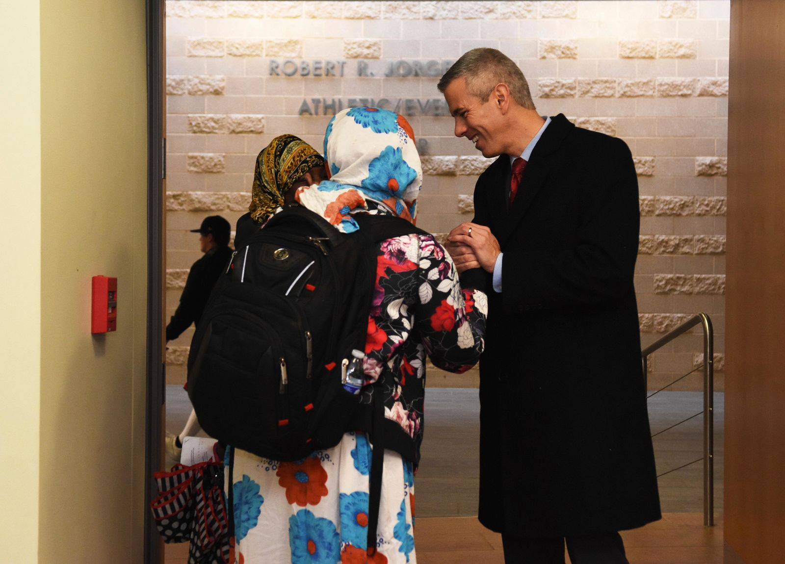Anthony Brindisi, right, the Democratic candidate for New York's 22nd Congressional District, chats with Habiba Mberwa, left, after casting his vote at Mohawk Valley Community College in Utica, N.Y., Tuesday, Nov. 6, 2018. (AP Photo/Heather Ainsworth)