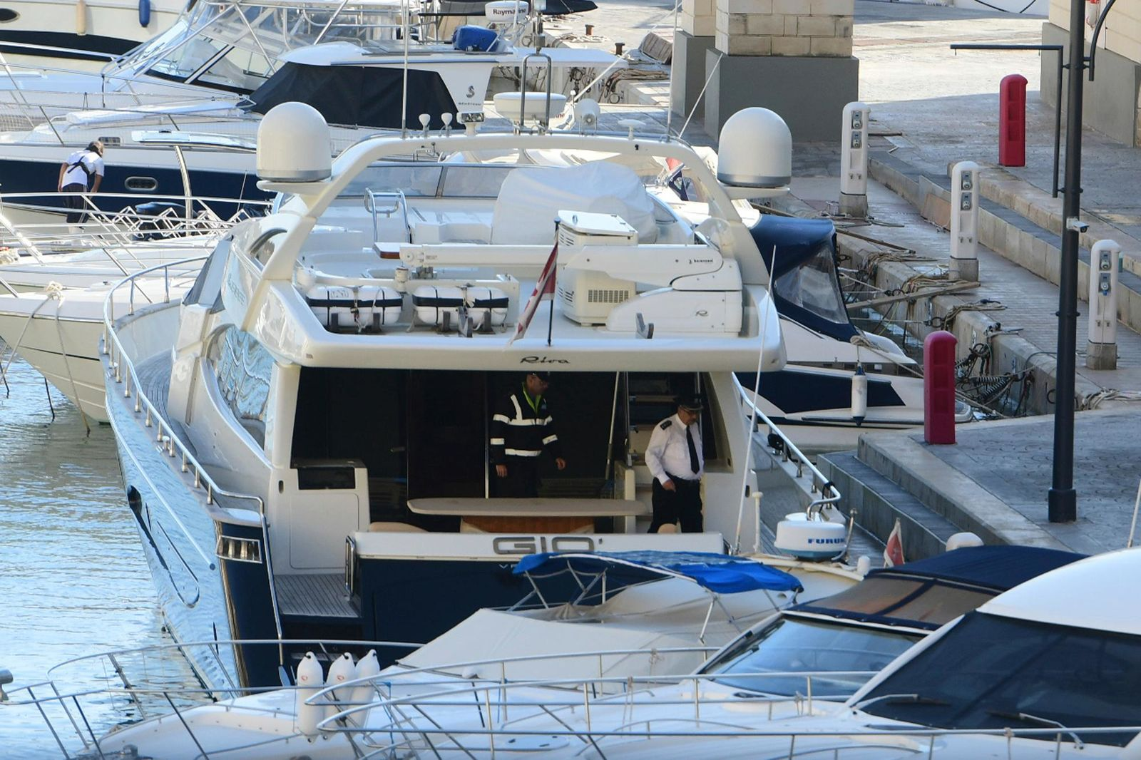 "Police aboard the yacht ""Gio"" after it was intercepted on a course for Sicily by the Maltese military early Wednesday, Nov. 20, 2019, and forced back to Portomaso, Malta. (AP Photo/Jonathan Borg)"
