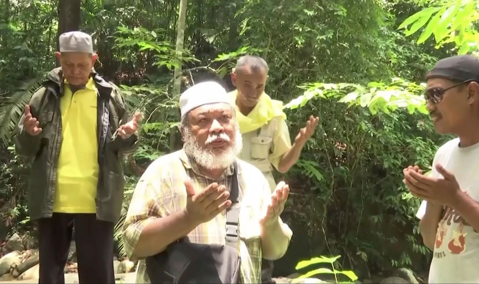 In this image made from a video, shaman perform rituals for missing schoolgirl Nora Anne Quoirin at a forest in Seremban, Malaysia Monday, Aug. 12, 2019.{ } (RTM via AP)