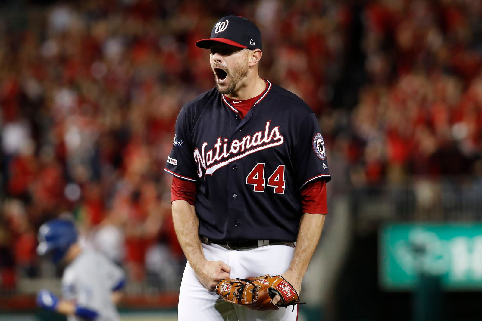 Washington Nationals relief pitcher Daniel Hudson (44) celebrates the final out of Game 4 of a baseball National League Division Series against the Los Angeles Dodgers, Monday, Oct. 7, 2019, in Washington. (AP Photo/Alex Brandon)
