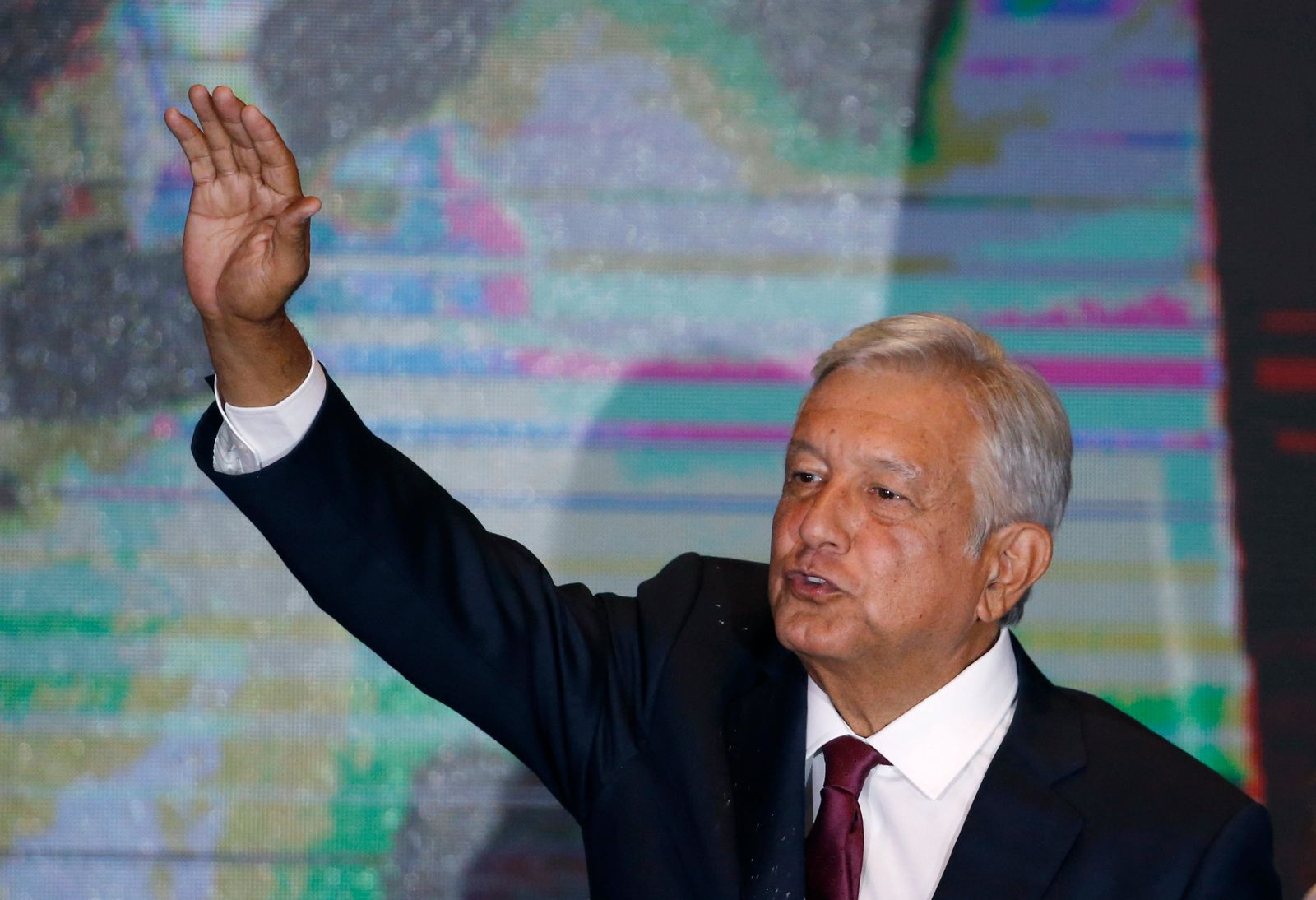Presidential candidate Andres Manuel Lopez Obrador waves to supporters as he gives his first victory speech at his campaign headquarters in Mexico City, Sunday, July 1, 2018. (AP Photo/Marco Ugarte)
