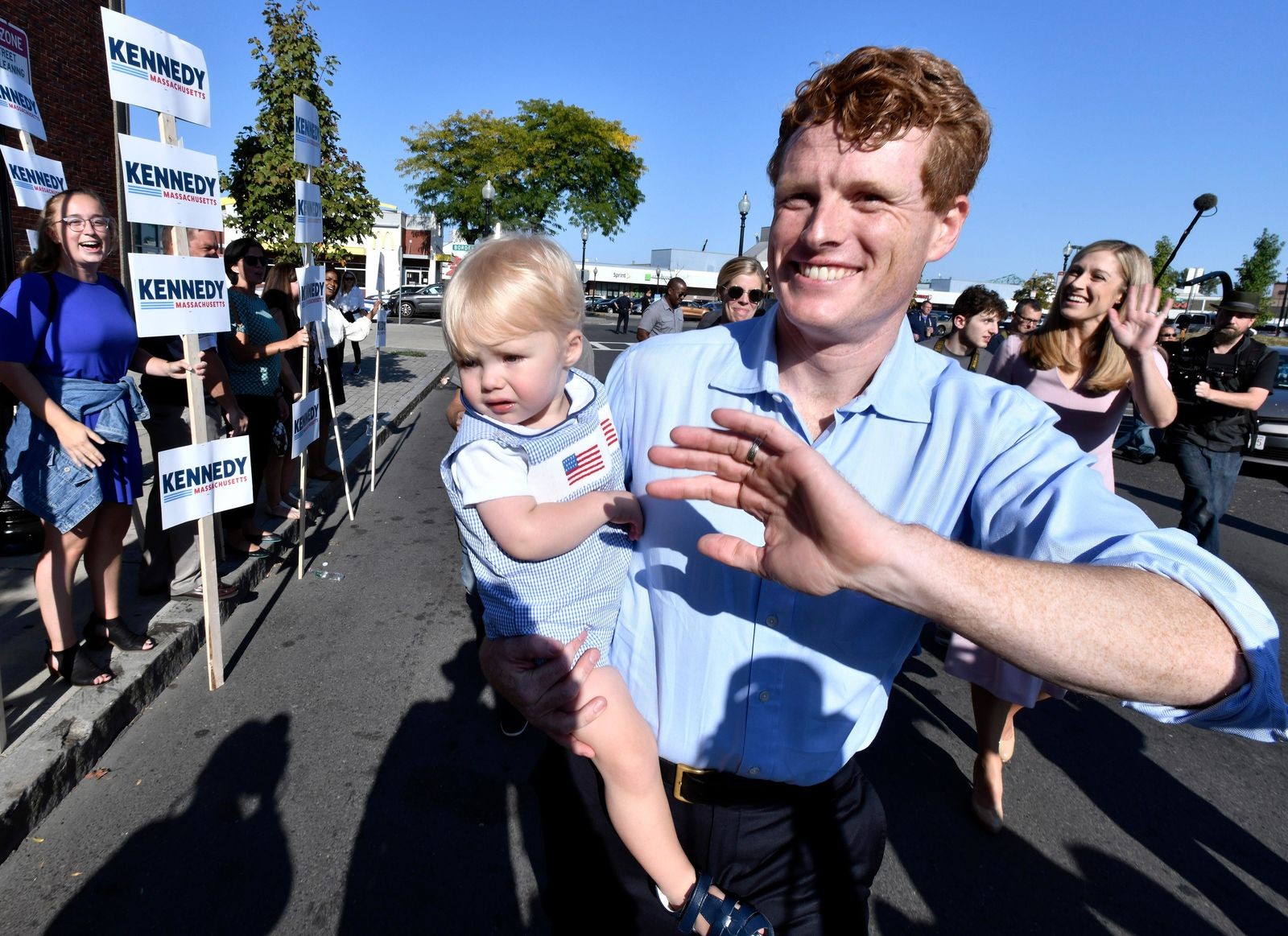 Democratic U.S. Rep. Joseph Kennedy III, D-Mass., waves to supporters as he arrives with family members, from left, his son James Kennedy, 1, and wife Lauren Kennedy, in East Boston to announce his candidacy for the Senate on Saturday, Sept. 21, 2019, in Boston. Kennedy will challenge incumbent Sen. Ed Markey in the Democratic primary. (AP Photo/Josh Reynolds)