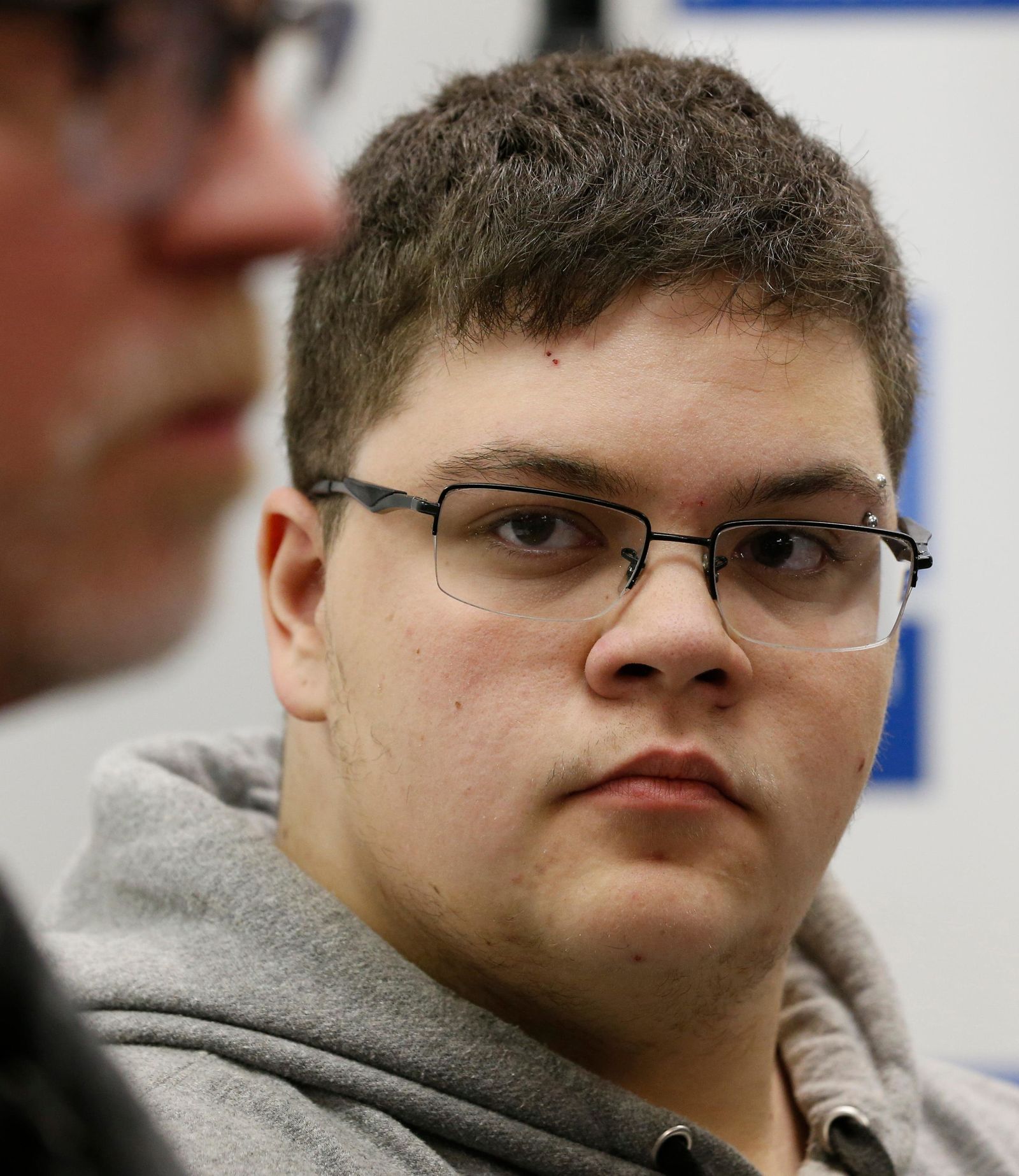 FILE - In this March 6, 2017, file photo, Gloucester County High School senior Gavin Grimm, a transgender student, listens to a speaker during a news conference in Richmond, Va. (AP Photo/Steve Helber, File)