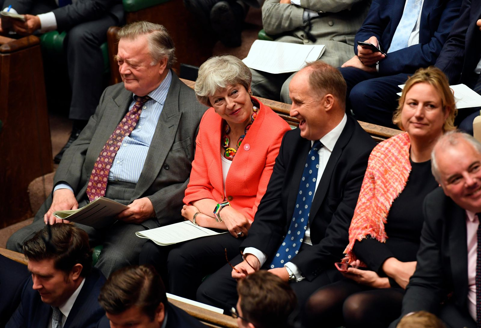 In this handout photo provided by the House of Commons, former Prime Minister Theresa May, second left, looks on during Boris Johnson's first Prime Minister's Questions, in the House of Commons in London, Wednesday, Sept. 4, 2019. (Jessica Taylor/House of Commons via AP)