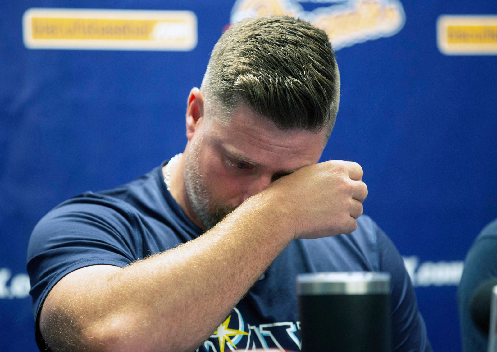Montgomery Biscuits manager Morgan Ensberg wipes away tears during a news conference about pitcher Blake Bivens' wife and child who were killed in a triple homicide, Thursday, Aug. 29, 2019 in Montgomery, Ala. (Kirsten Fiscus/Montgomery Advertiser via AP)
