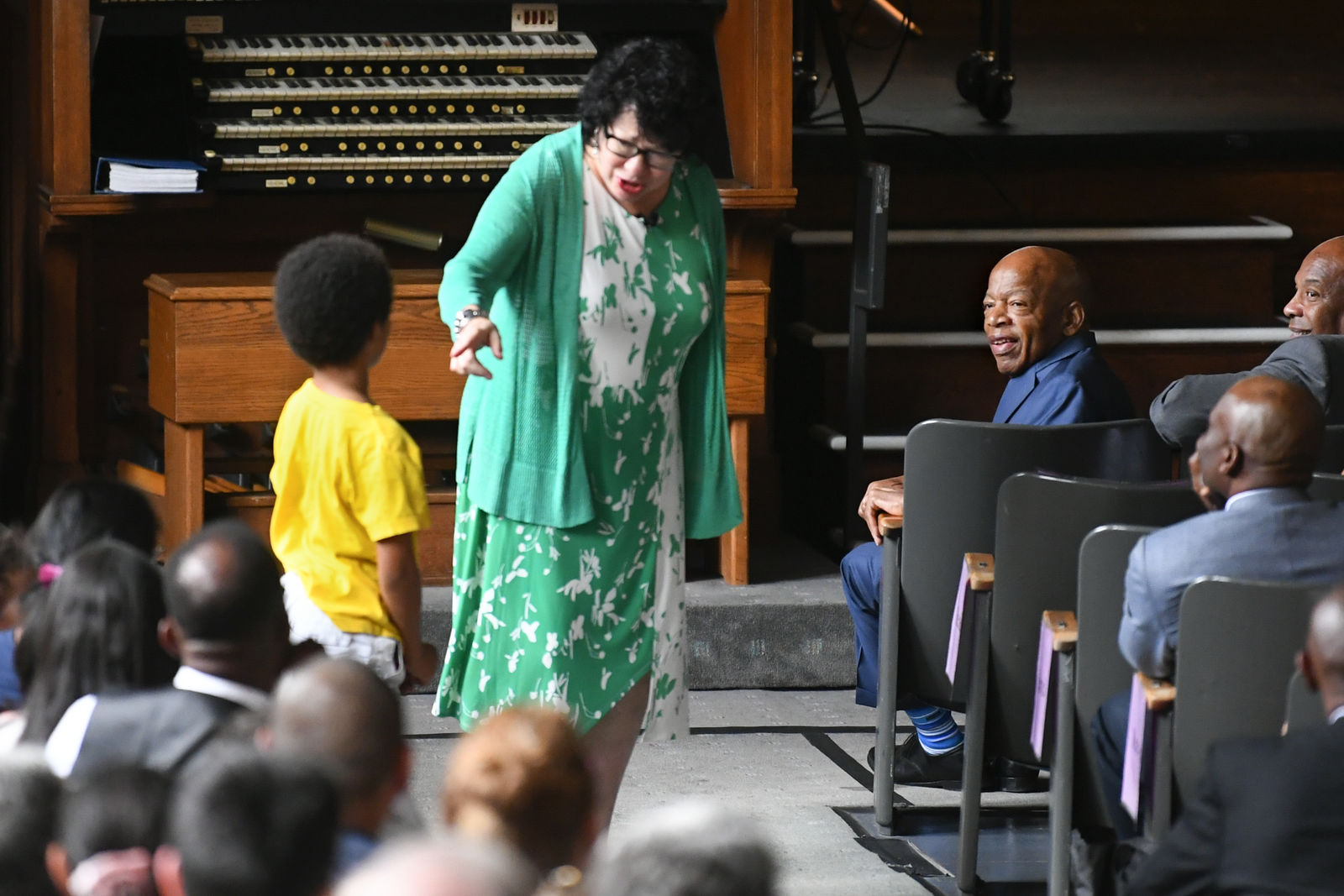 "U.S. Rep. John Lewis, D-Ga., right, watches as U.S. Supreme Court Justice Sonia Sotomayor, center, responds to a question from a child during an event promoting her new children's book ""Just Ask!"" in Decatur, Ga., Sunday, Sept. 1, 2019. (AP Photo/John Amis)"