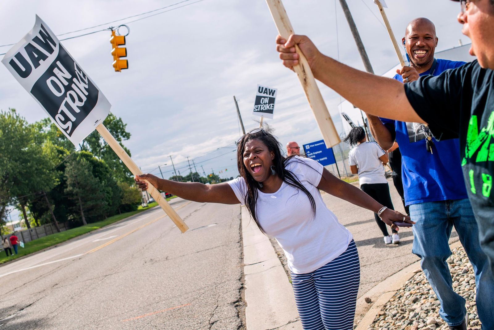 Flint resident Dorrit Madison, who has worked at the plant for more than 11 years, shouts out at cars passing by as General Motors employees demonstrate outside of the Flint Assembly Plant on Sunday, Sept. 15, 2019 in Flint. GM autoworkers in Lansing officially go on strike at midnight Sunday after UAW leadership voted to do so Sunday morning.{ } (Jake May/The Flint Journal via AP)