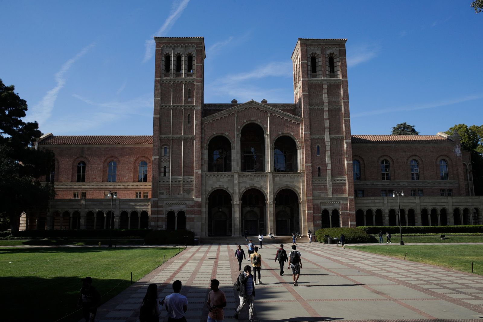Students walk past Royce Hall at the University of California, Los Angeles Thursday, April 25, 2019, in the Westwood section of Los Angeles. (AP Photo/Jae C. Hong)