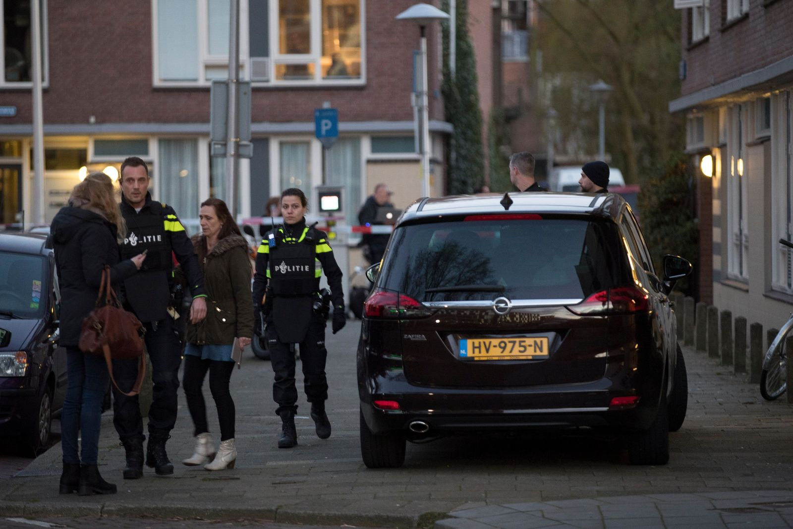 Dutch police stand guard outside a house where the suspect of a shooting incident in a tram was arrested in Utrecht, Netherlands, Monday, March 18, 2019.(AP Photo/Peter Dejong)