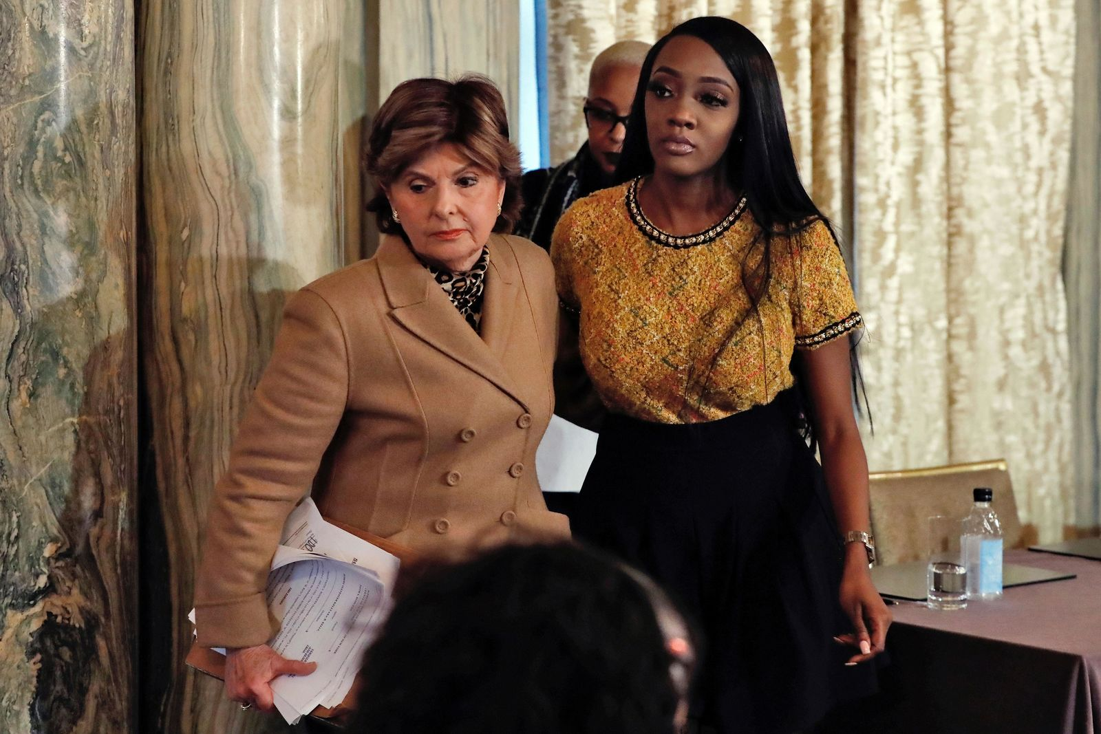 "Attorney Gloria Allred, left escorts Faith Rogers after a news conference about R&B singer R. Kelly in New York, Monday, Jan. 14, 2019. Kelly has been under fire since the recent airing of a Lifetime documentary ""Surviving R. Kelly ."" He has denied all allegations of sexual misconduct involving women and underage girls. (AP Photo/Richard Drew)"