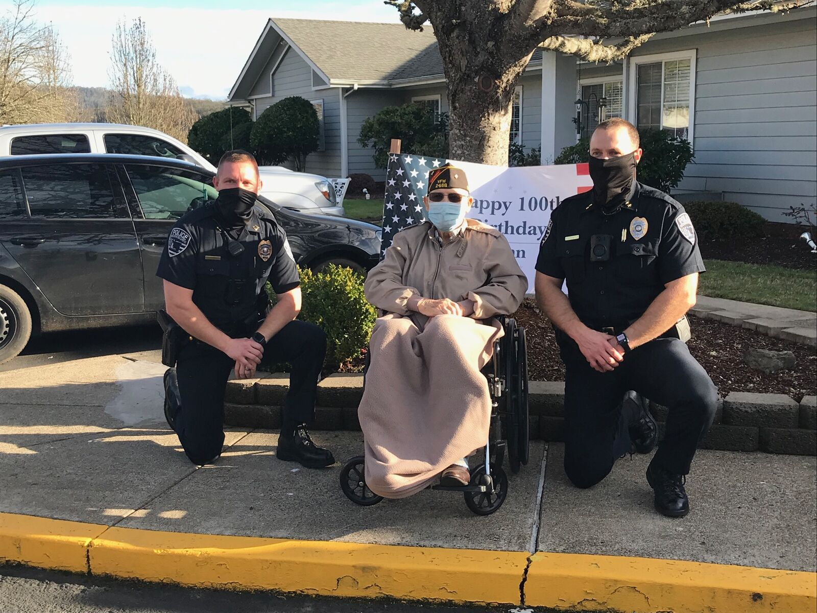 WWII veteran John Crouch celebrates his 100th birthday with a visit from members of the the Roseburg Police Department, Roseburg Fire Department, Oregon Army National Guard's Charlie Company, & several friends, Jan 13, 2021. (Photo courtesy Roseburg PD)