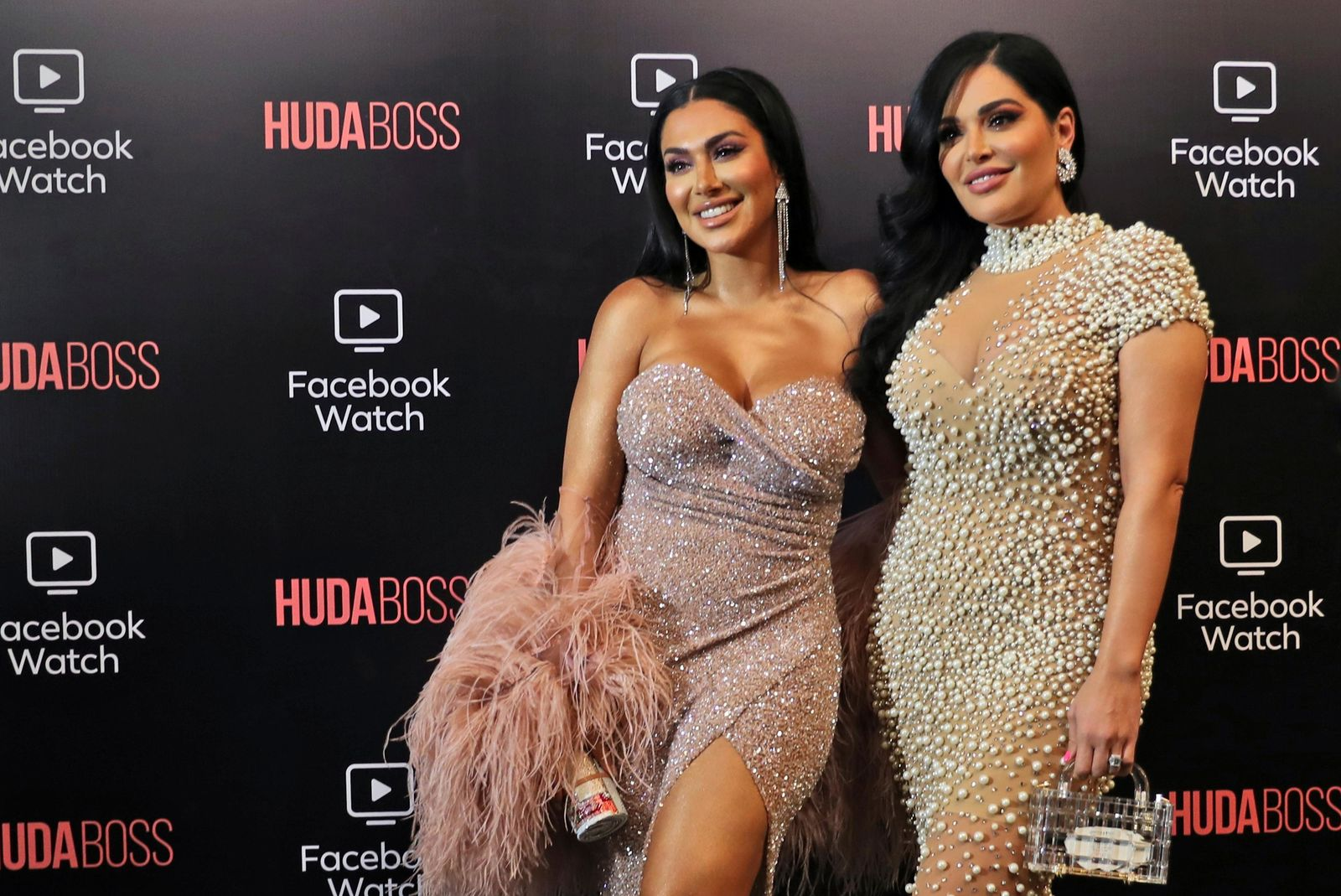Huda Kattan, left, and Mona Kattan, pose at the Huda Boss on Facebook Watch screening celebration in Dubai, United Arab Emirates, Wednesday, Oct. 9, 2019. (AP Photo/Kamran Jebreili)