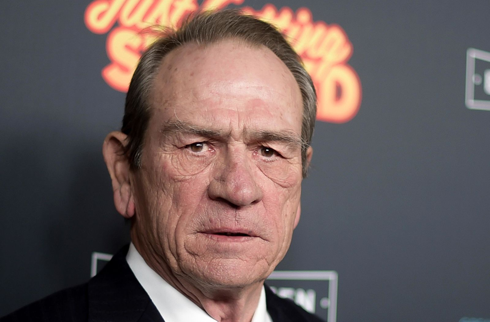 "FILE - This Dec. 7, 2017 file photo shows Tommy Lee Jones at the LA Premiere of ""Just Getting Started"" at ArcLight Hollywood in Los Angeles. Oscar winners, Jones, Robert De Niro, and Morgan Freeman soon will be on their way to New Mexico to start work on ""The Comeback Trail."" (Photo by Richard Shotwell/Invision/AP, File)"