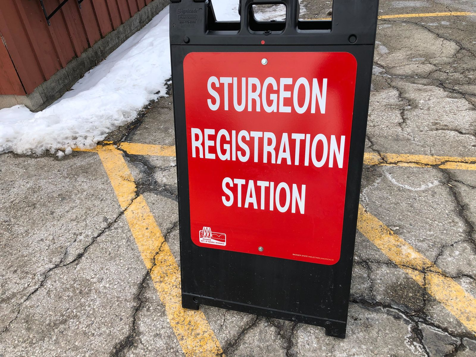 Sturgeon registration station sign at Jim and Linda's, February 17, 2020 (WLUK/Eric Peterson){ }