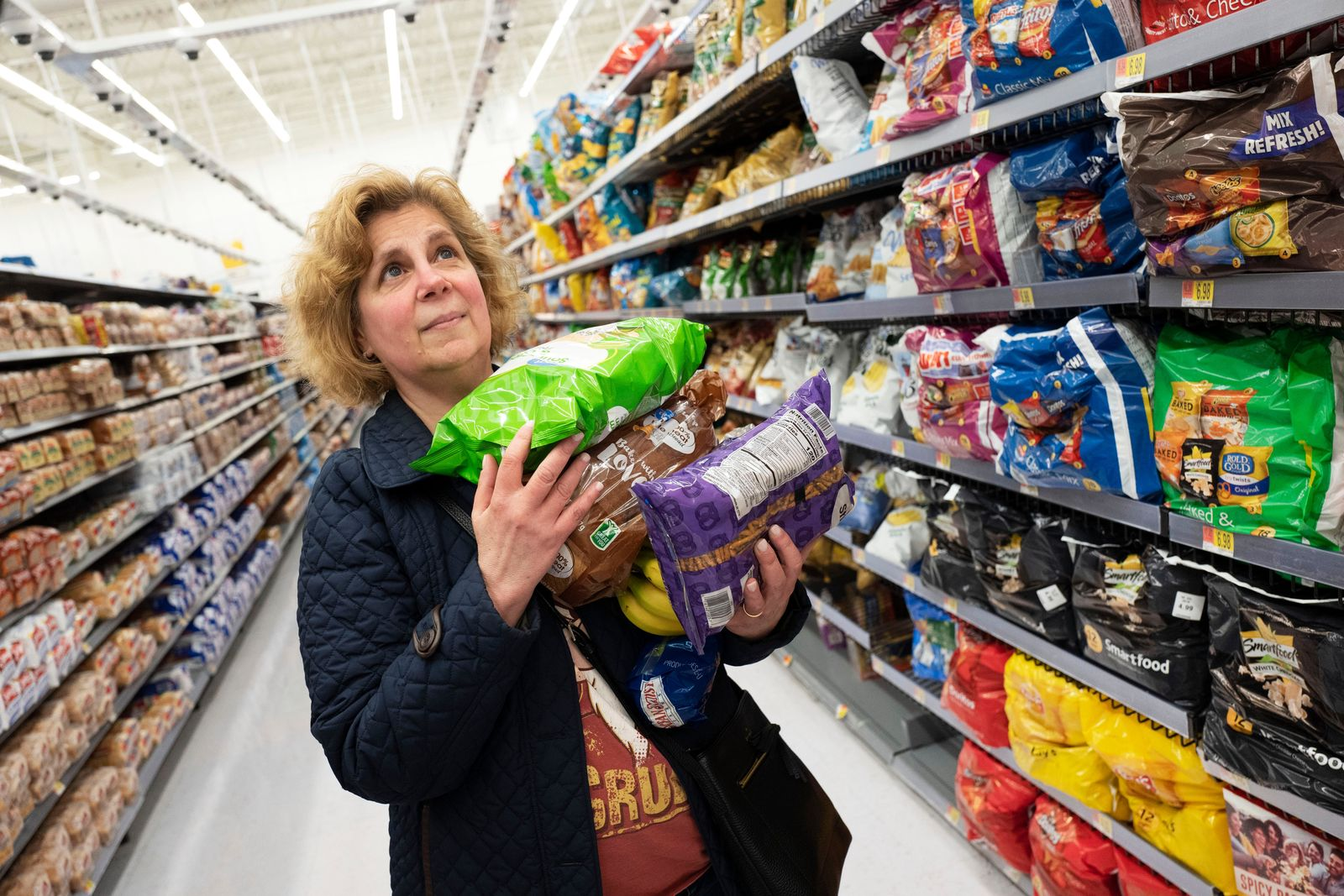 FILE - In this April 24, 2019, file photo Marcy Seinberg shops at a Walmart Neighborhood Market in Levittown, N.Y. (AP Photo/Mark Lennihan, File)