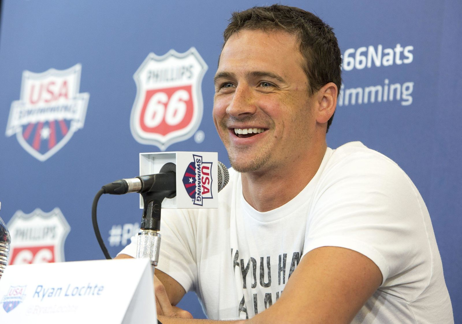 Ryan Lochte smiles as he takes questions from the media at the U.S. swimming nationals news conference in Irvine, Calif., on Tuesday. AP PHOTO