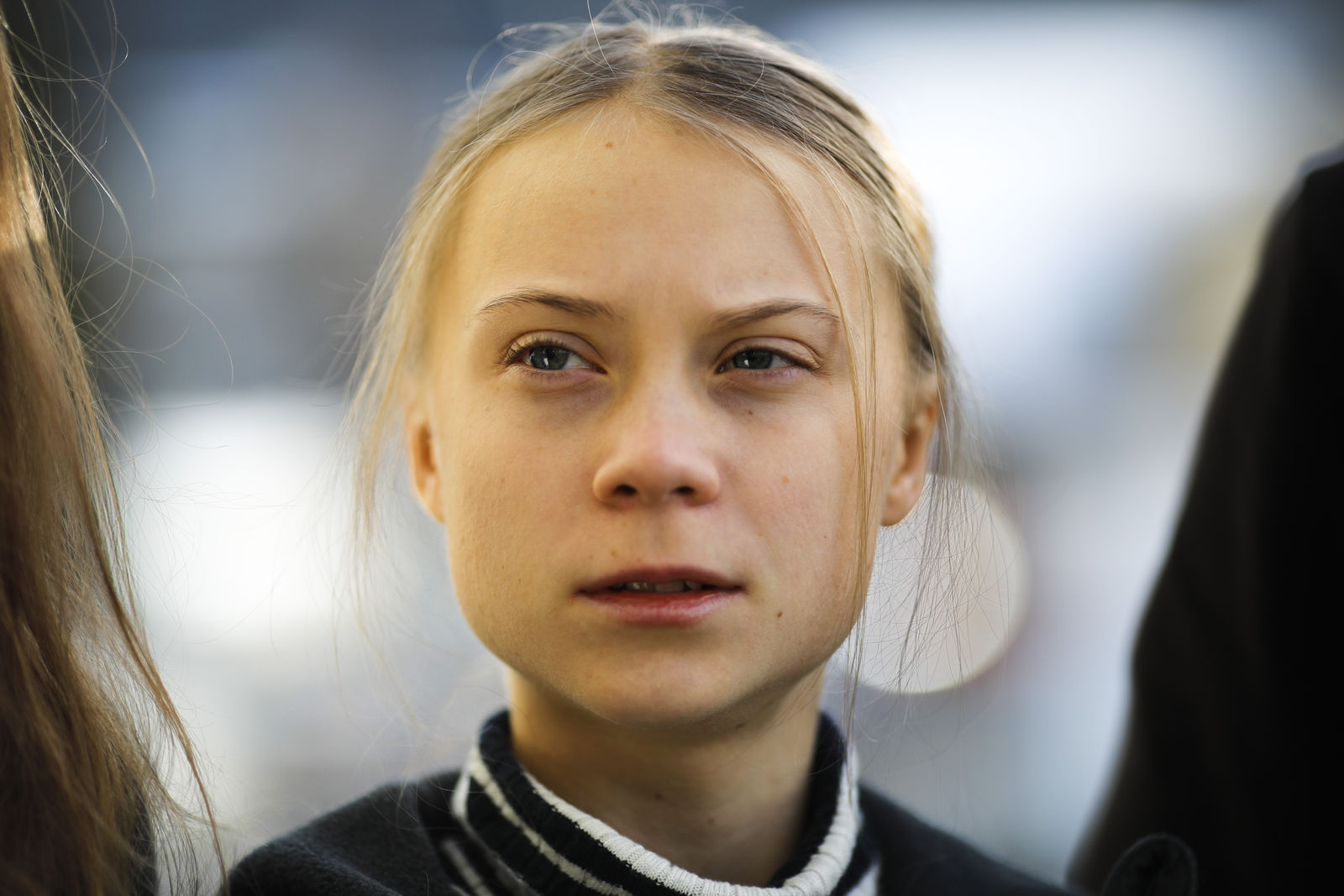 Swedish climate activist Greta Thunberg poses for media as she arrives for a news conference in Davos, Switzerland, Friday, Jan. 24, 2020. The 50th annual meeting of the forum is taking place in Davos from Jan. 21 until Jan. 24, 2020 (AP Photo/Markus Schreiber)