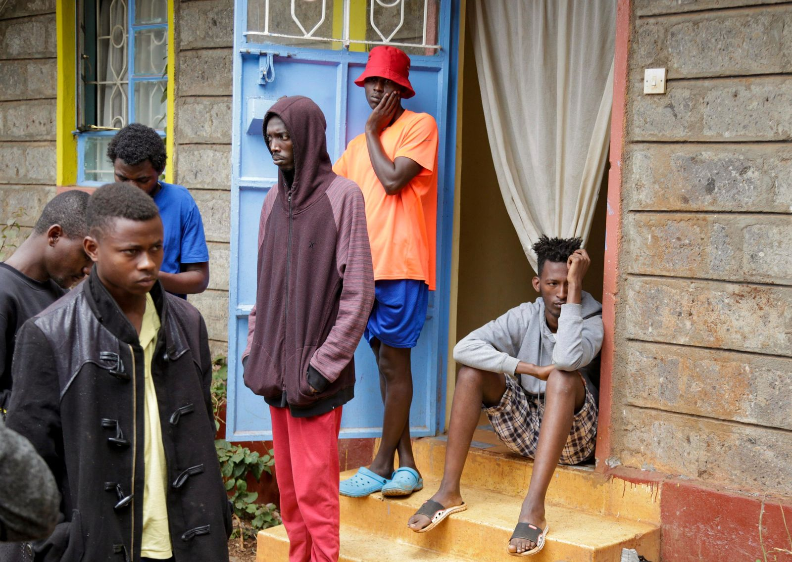 In this photo taken Tuesday, May 28, 2019, LGBT refugees stand outside the house where they take shelter in a low-income neighborhood of the capital Nairobi, Kenya.{ } (AP Photo/Khalil Senosi)