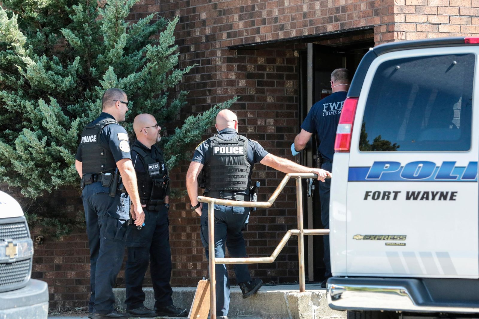 Officers from the Fort Wayne Police Department search the former site of an abortion clinic owned by Dr. Ulrich Klopfer, Thursday, Sept. 19, 2019, in Fort Wayne, Ind. St. Joseph County Prosecutor Ken Cotter said Thursday that authorities have found no fetal remains at a shuttered abortion clinic once operated by the late abortion doctor whose Illinois property was found to contain more than 2,200 medically preserved fetal remains. (Eric Ginnard/The Herald-News via AP)