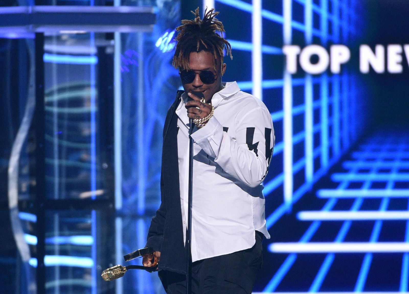 "FILE - In this May 1, 2019 file photo, Juice WRLD accepts the award for top new artist at the Billboard Music Awards at the MGM Grand Garden Arena in Las Vegas. The Chicago-area rapper, whose real name is Jarad A. Higgins, was pronounced dead Sunday, Dec. 8 after a ""medical emergency'' at Chicago's Midway International Airport, according to authorities. Chicago police said they're conducting a death investigation. (Photo by Chris Pizzello/Invision/AP, File)"
