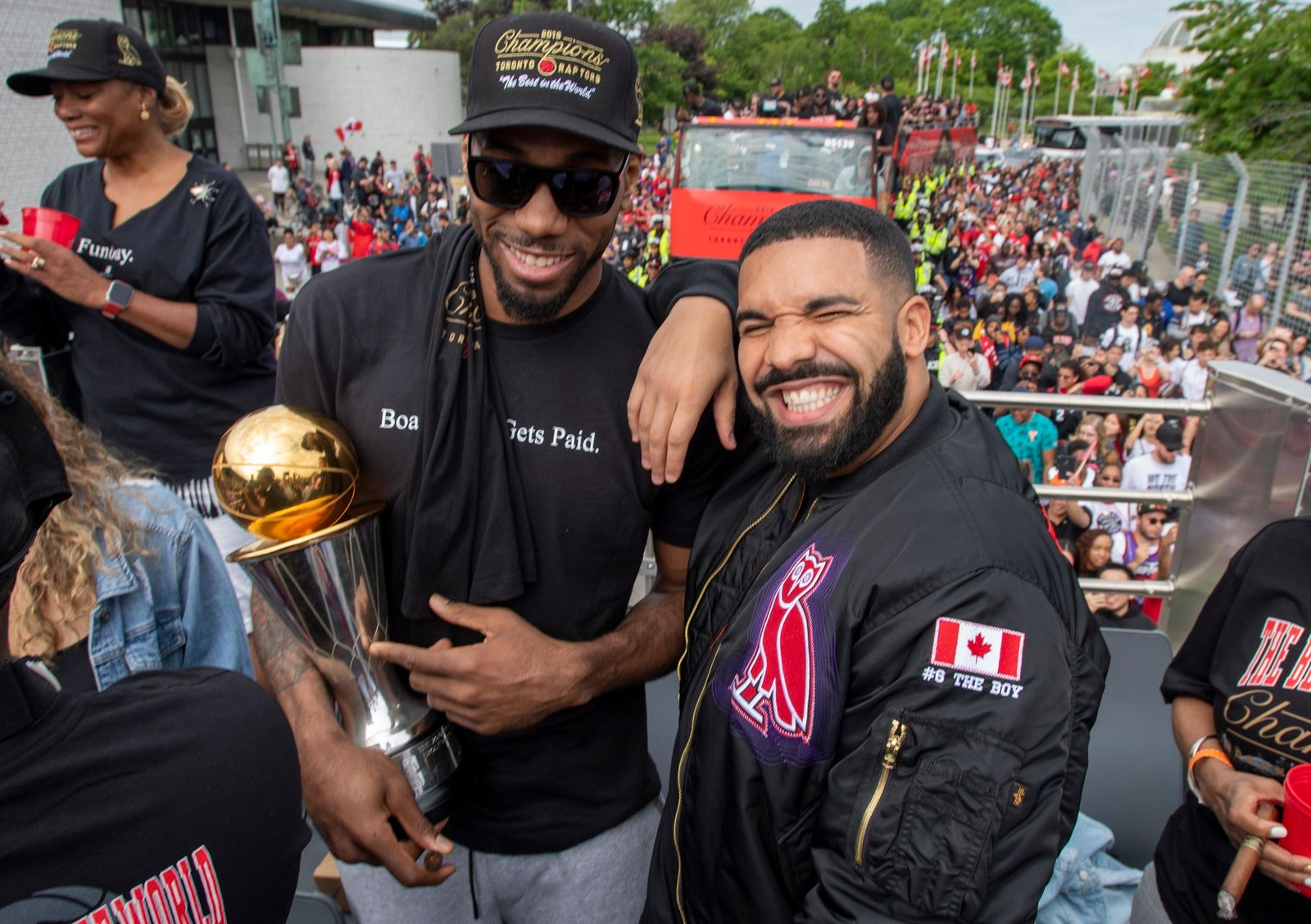 Toronto Raptors' Kawhi Leonard, front left, holds his MVP trophy while posing with rapper/producer Drake as they celebrate during the team's NBA basketball championship parade in Toronto, Monday, June 17, 2019. (Frank Gunn/The Canadian Press via AP)