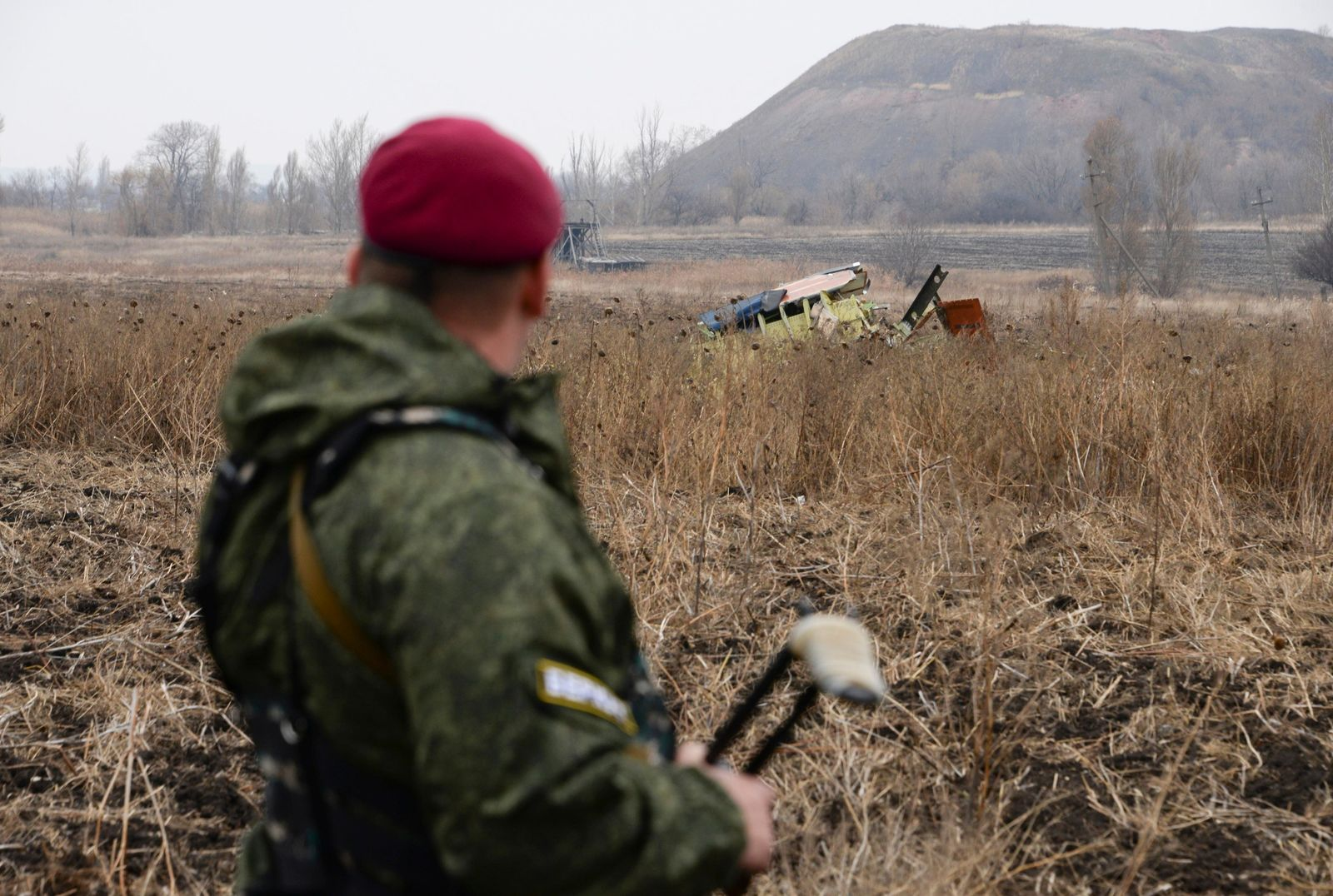 FILE - In this file photo dated Tuesday, Nov. 11, 2014, Pro-Russian rebel fighter guards one of the areas of the Malaysia Airlines Flight 17 plane crash in the village of Rossypne, Donetsk region, eastern Ukraine. (AP Photo/Mstyslan Chernov, FILE)