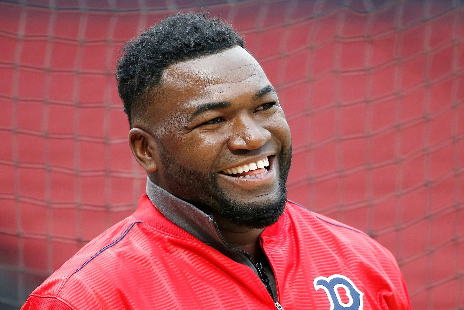 FILE - In this April 12, 2016, file photo, Boston Red Sox's David Ortiz smiles during batting practice before a baseball game against the Baltimore Orioles, in Boston. Former Boston Red Sox slugger David Ortiz was hospitalized Monday following surgery for a gunshot wound after being ambushed by a man in a bar in his native Dominican Republic, authorities said. (AP Photo/Michael Dwyer, File)