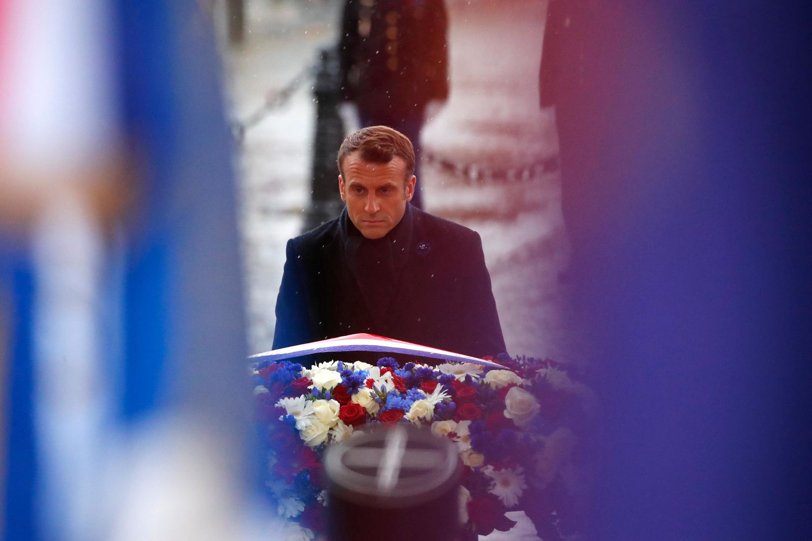French President Emmanuel Macron lays a wreath of flowers at the tomb of the Unknown Soldier under the Arc de Triomphe in Paris Monday Nov. 11, 2019 during commemorations marking the 101st anniversary of the 1918 armistice, ending World War I. (AP Photo/Francois Mori, Pool)