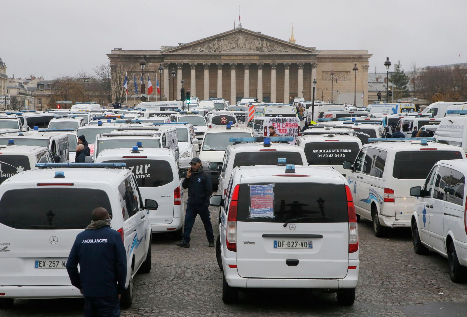 Ambulance workers block the bridge leading the National Assembly, background, in Paris, Monday, Dec. 3. (AP Photo/Michel Euler)