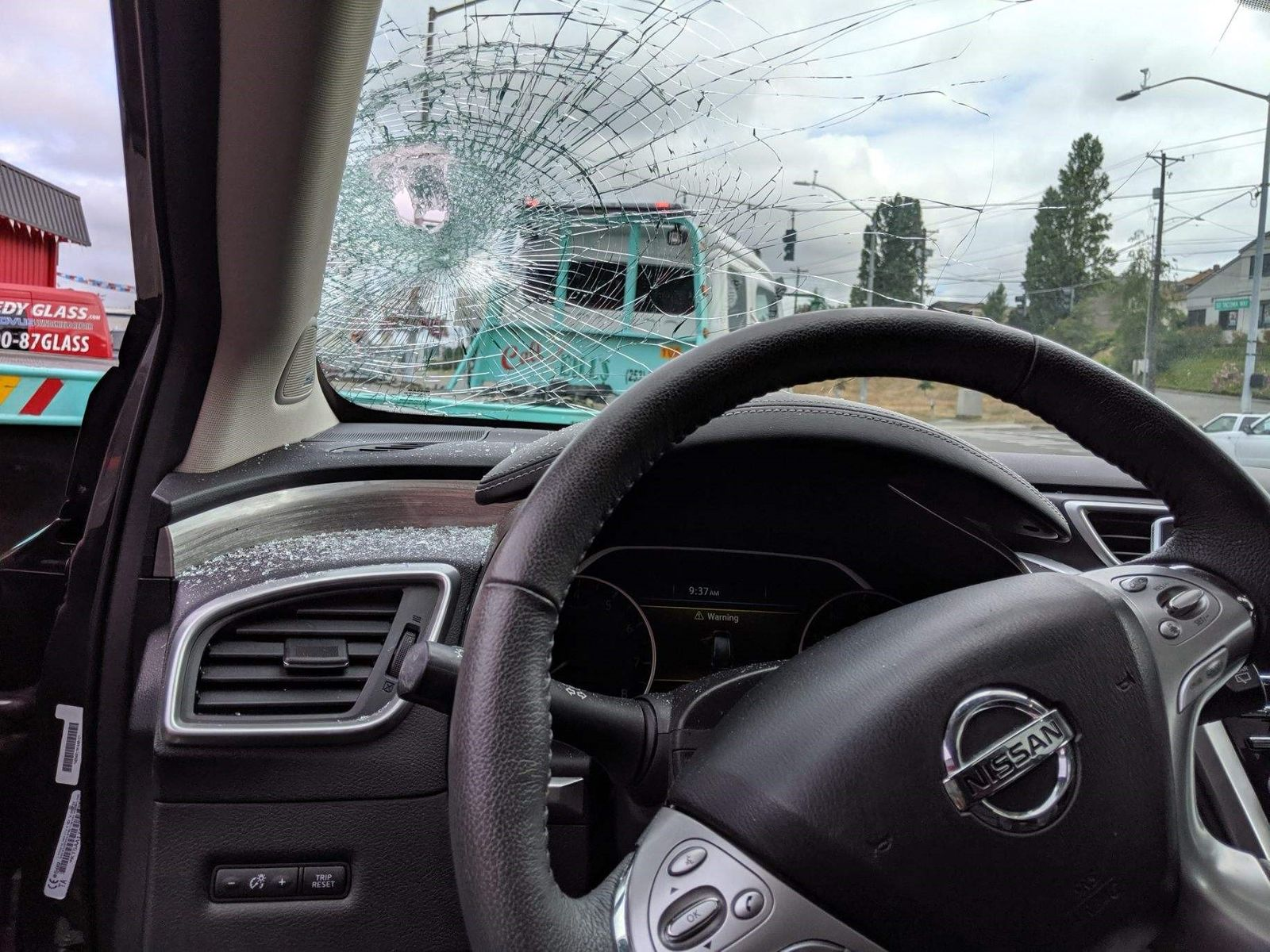 A large piece of metal tubing smashes into a driver's windshield in Tacoma (Photo: Marc Ross)