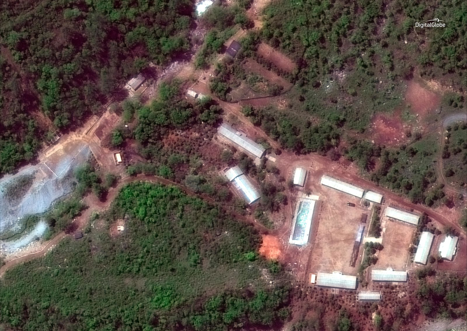 FILE - This Wednesday, May 23, 2018 satellite file image provided by DigitalGlobe, shows the Punggye-ri test site in North Korea. North Korea has carried out what it says is the demolition of its nuclear test site in the presence of foreign journalists. (DigitalGlobe via AP, File)
