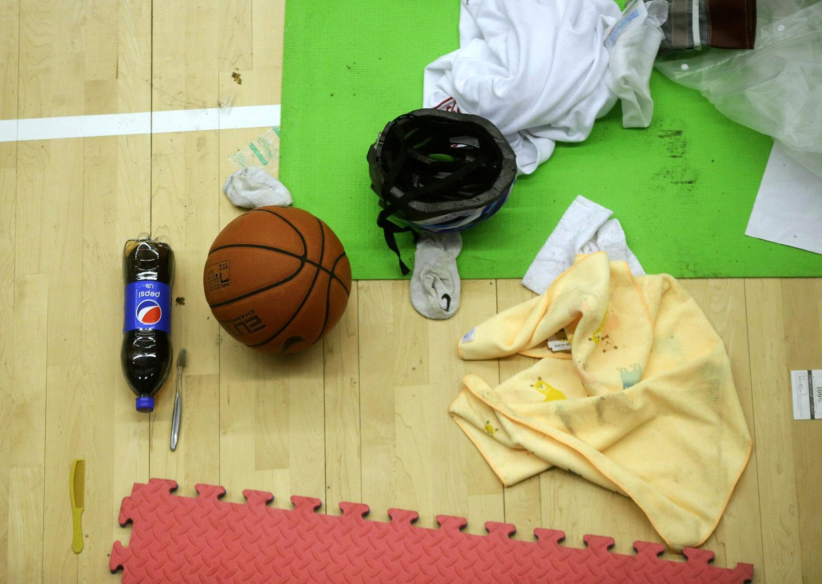 Clothes and a basketball belonging to protesters are left in the campus of the Polytechnic University in Hong Kong, Wednesday, Nov. 20, 2019. (AP Photo/Ahmad Ibrahim)