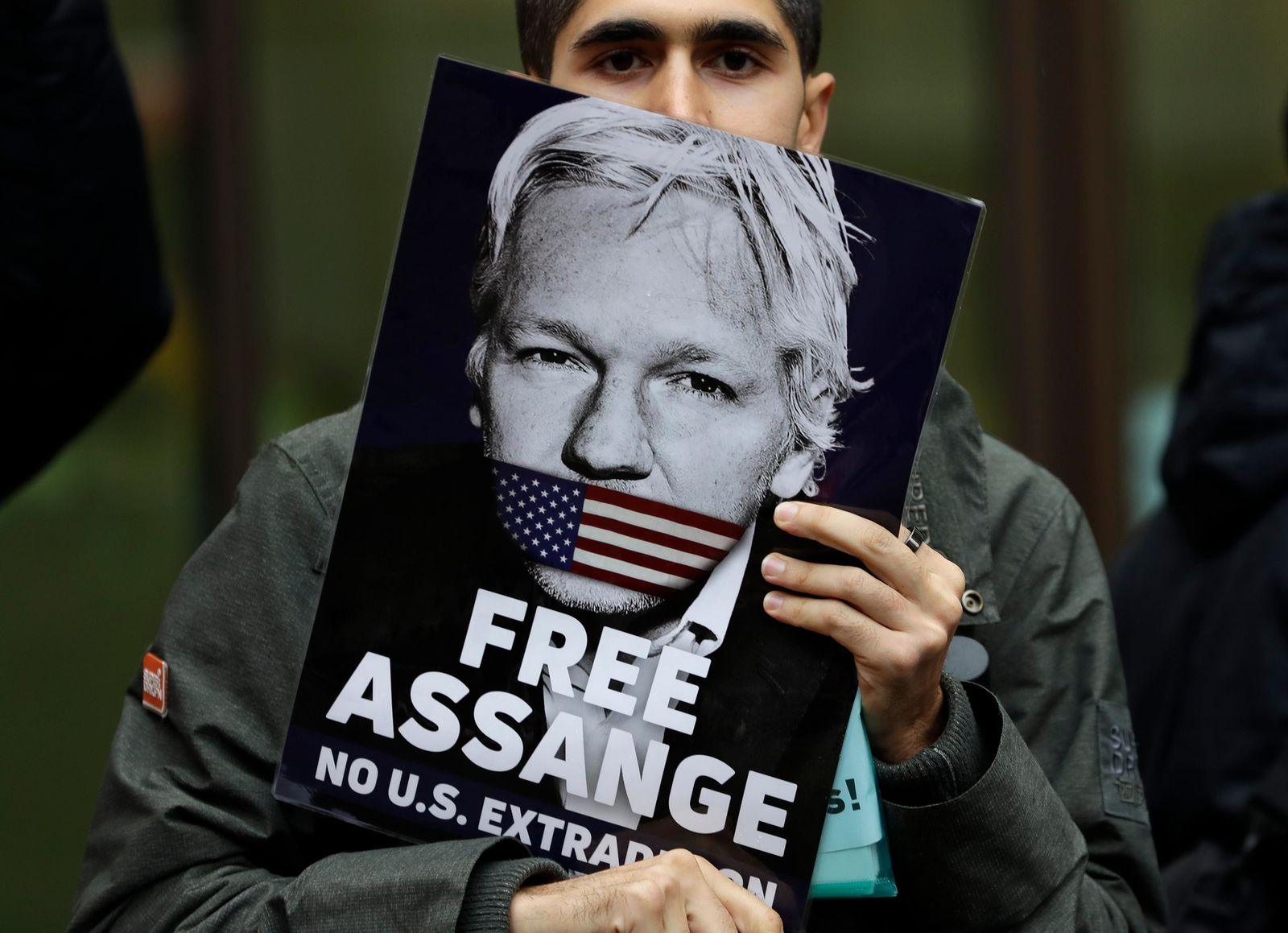 Supporters of Wikileaks founder Julian Assange demonstrate outside Westminster Magistrates' Court in London where Assange is expected to appear as he fights extradition to the United States on charges of conspiring to hack into a Pentagon computer, in London, Monday Oct. 21, 2019. (AP Photo/Kirsty Wigglesworth)