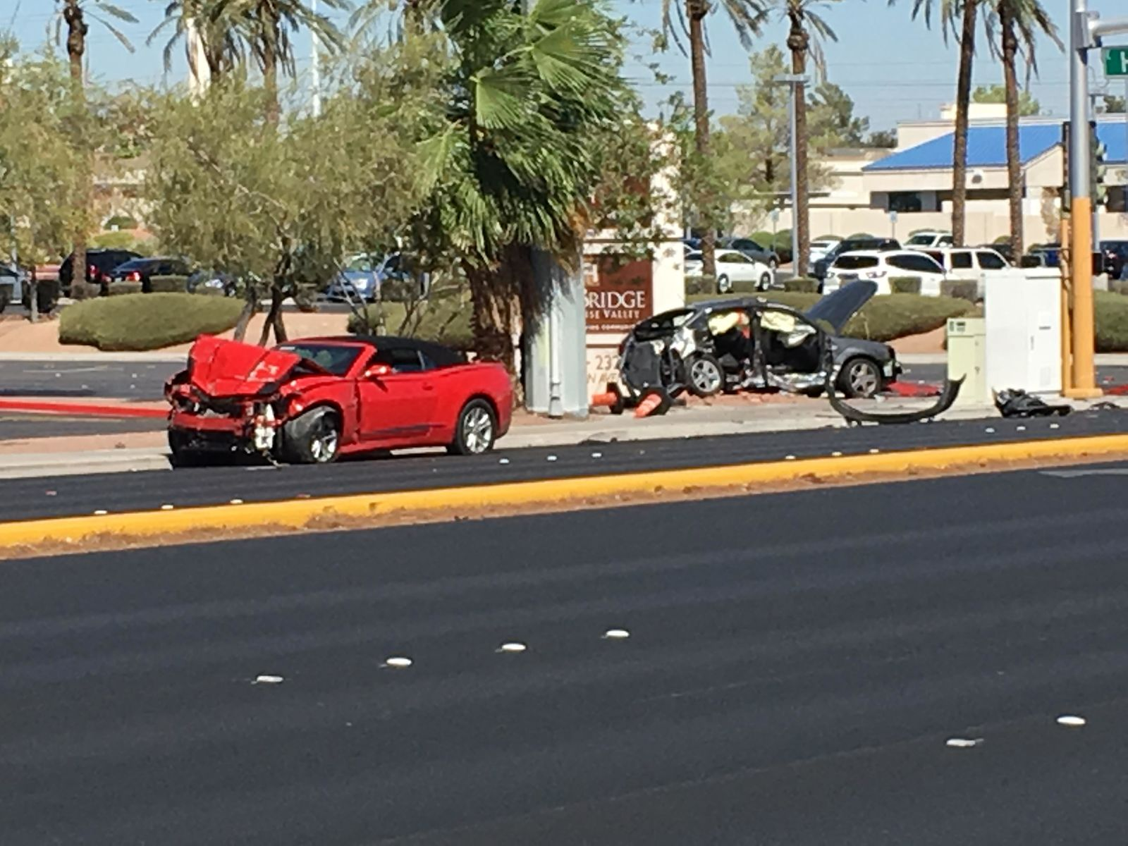 Two vehicles are damaged after a crash at Eastern Avenue and Harmon Road in Las Vegas on Friday, Aug. 31, 2018. (KSNV)