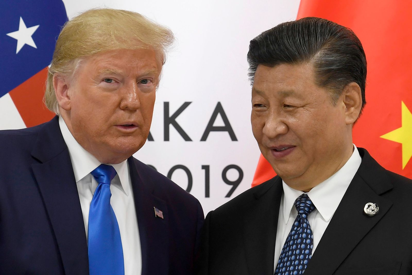 "FILE - In this June 29, 2019, file photo, U.S. President Donald Trump poses for a photo with Chinese President Xi Jinping during a meeting on the sidelines of the G-20 summit in Osaka, western Japan. Chinese Commerce Ministry spokesman Gao Feng said Beijing is working to resolve conflicts with Washington over trade, dismissing speculation the talks might be in trouble as unreliable ""rumors."" Trump had said he hoped to sign a preliminary agreement with Xi by this month. (AP Photo/Susan Walsh, File)"