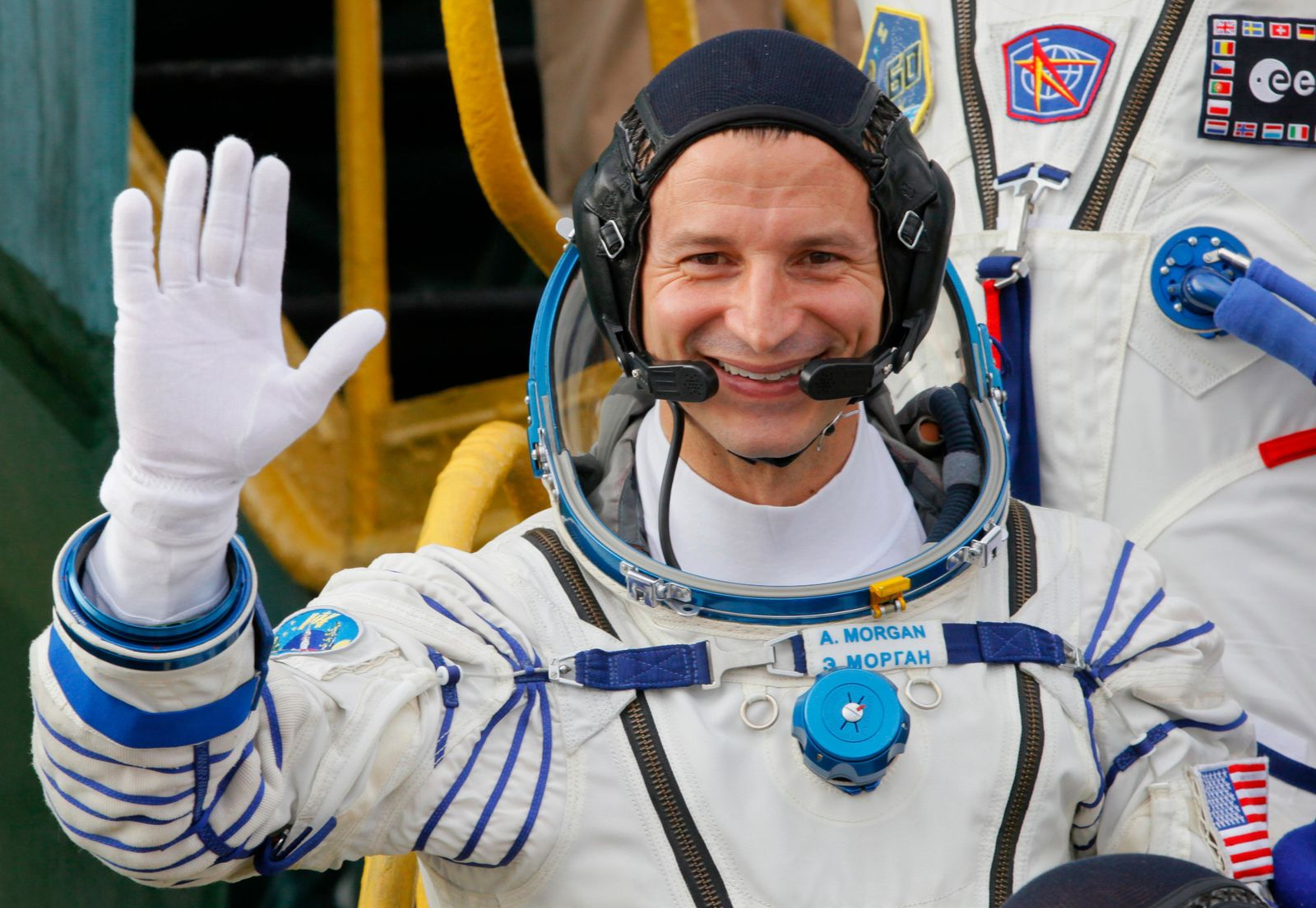 U.S. astronaut Andrew Morgan, crew member of the mission to the International Space Station, ISS, waves as he boards prior to the launch of Soyuz-FG rocket at the Russian leased Baikonur cosmodrome, Kazakhstan, Saturday, July 20, 2019. (AP Photo/Dmitri Lovetsky, Pool)