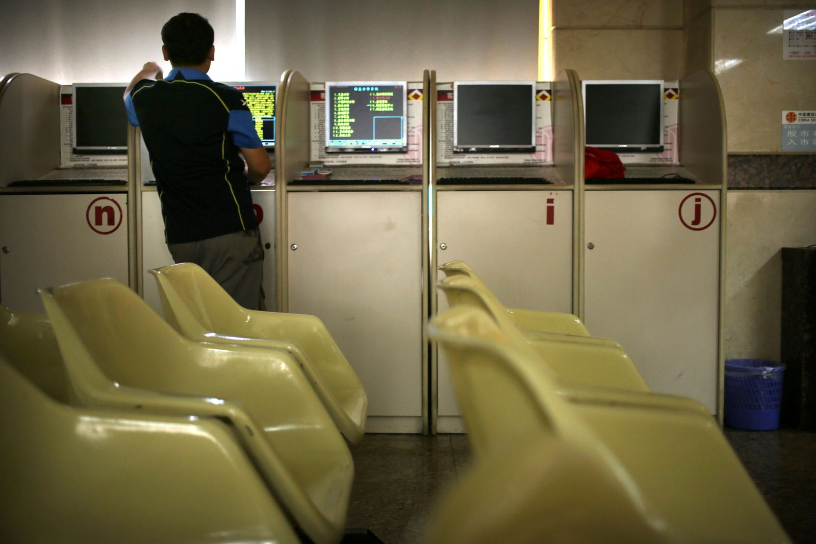 A Chinese investor uses a computer terminal as he monitors stock prices at a brokerage house in Beijing, Friday, Aug. 2, 2019.{ } (AP Photo/Mark Schiefelbein)