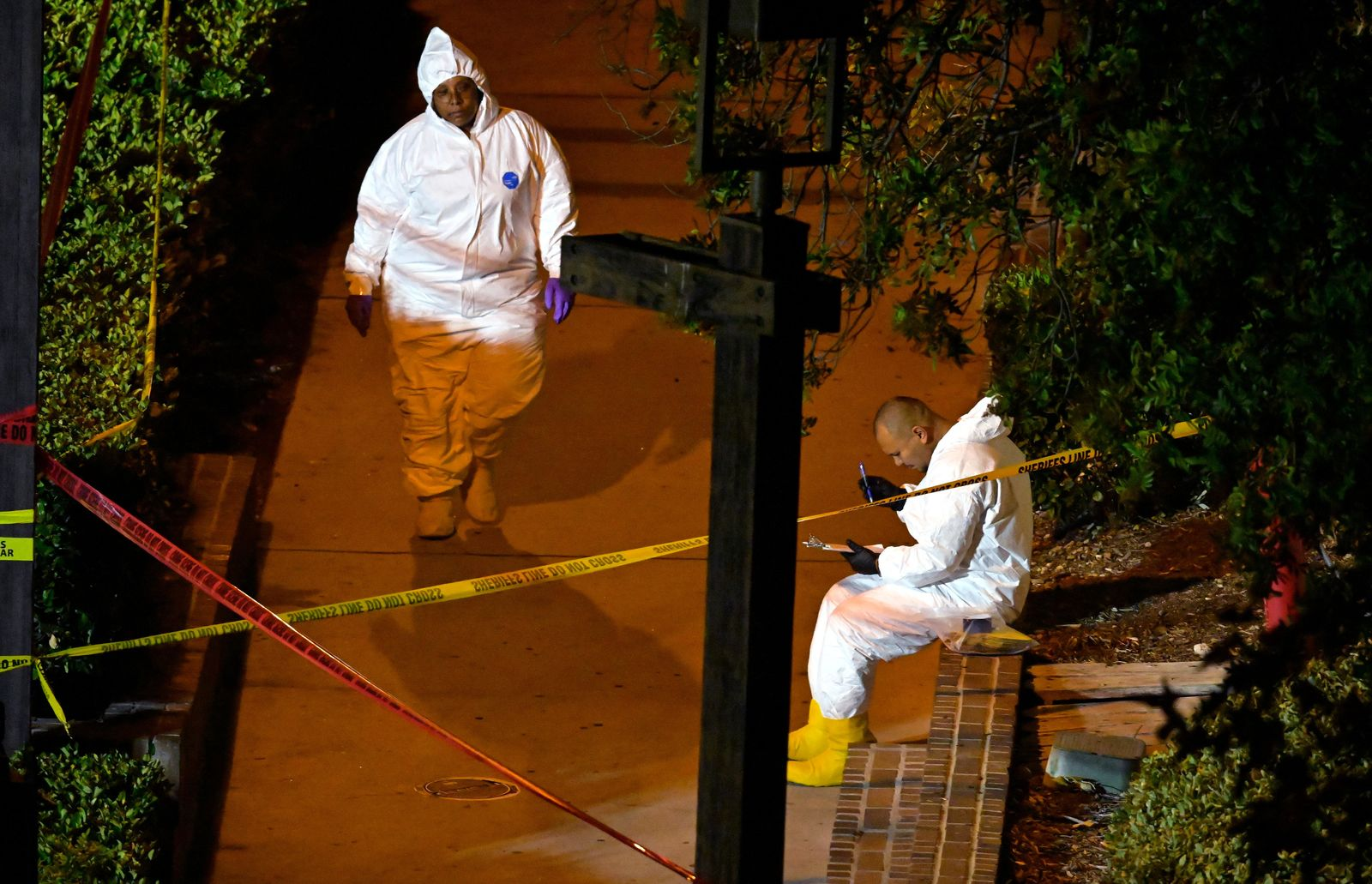 "A forensics team works the scene Thursday, Nov. 8, 2018, in Thousand Oaks, Calif.,where a gunman opened fire Wednesday inside a country dance bar crowded with hundreds of people on ""college night."" (AP Photo/Mark J. Terrill)"