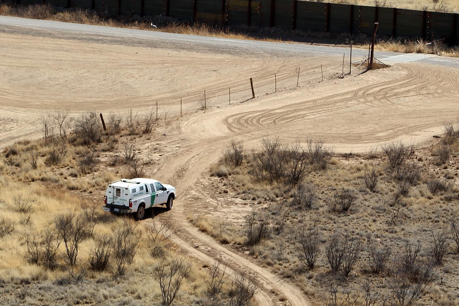 FILE: In this Jan 25, 2011 photo U.S. Customs and Border Protection agents monitor a section of fencing in Arizona near the Mexico border. (Photo, CBP/Donna BurtonATSCC Arizona CBP Operations)