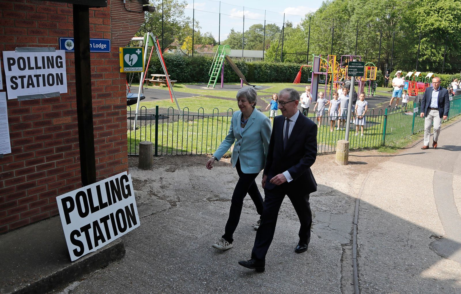 Britain's Prime Minister Theresa May and her husband Philip arrive at a polling station to vote in the European Elections in Sonning, England, Thursday, May 23, 2019.(AP Photo/Frank Augstein)